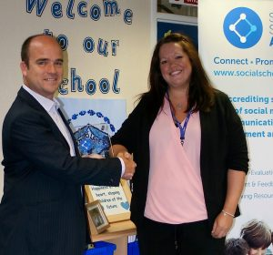 John Bidder Awarding the Social School Award to Headteacher Sarah White